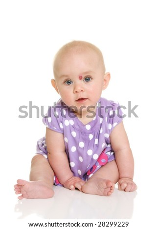 Baby Girl sitting Looking at Camera - stock photo