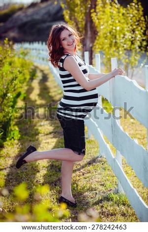 Baby girl sitting on green grass - stock photo