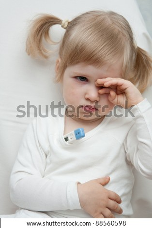 Baby girl takes the temperature - stock photo