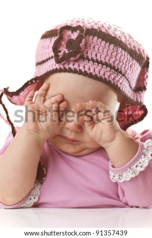Baby girl temper tantrum. Adorable baby girl dressed in pink rubbing her eyes - stock photo