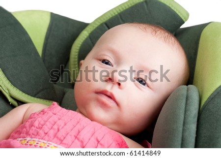 Baby girl toddler lying comfortable in car seat - stock photo