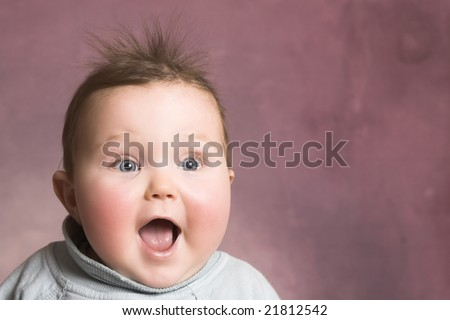 Baby girl with chubby cheeks and beautiful facial expressions - stock photo