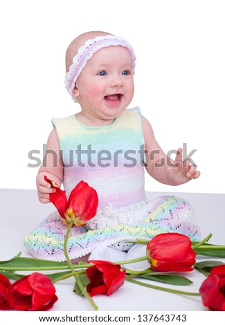 Baby girl with flowers. Isolated on white background - stock photo