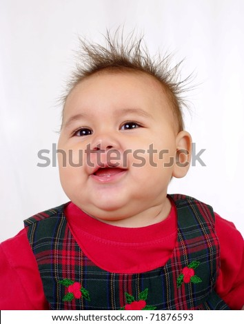 baby girl with funny spiked hair - stock photo