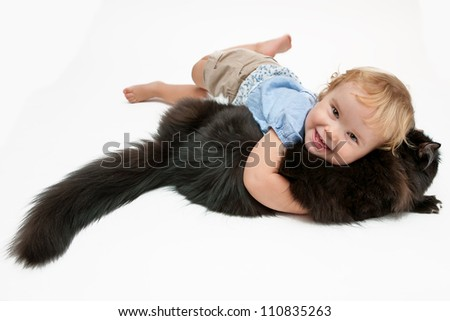 Baby girl with her cat - stock photo