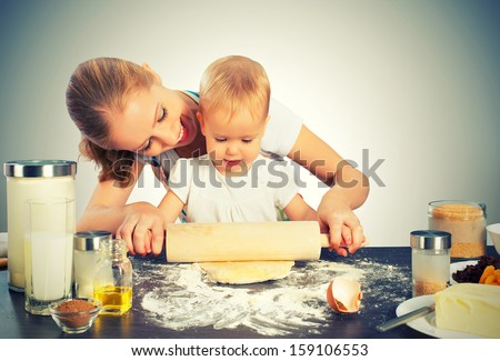 baby girl with her mother rolled out the dough cook, bake - stock photo