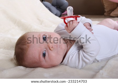 baby girl with her pacifier - stock photo