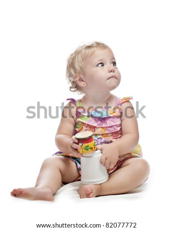 baby girl with toys - stock photo