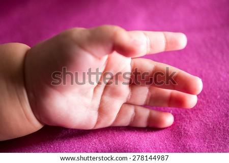 baby hand. - stock photo