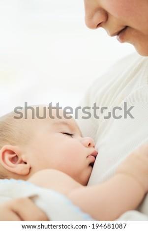 Baby having mom's care - stock photo