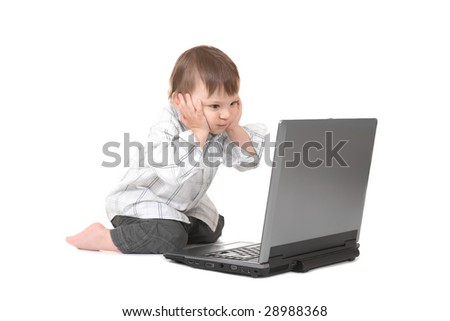 baby holding his head with laptop - stock photo