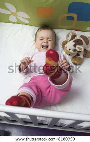 Baby  in a Crib - crying - stock photo