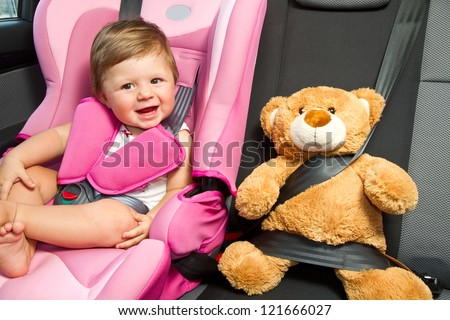 baby in a safety car seat. Safety and security - stock photo