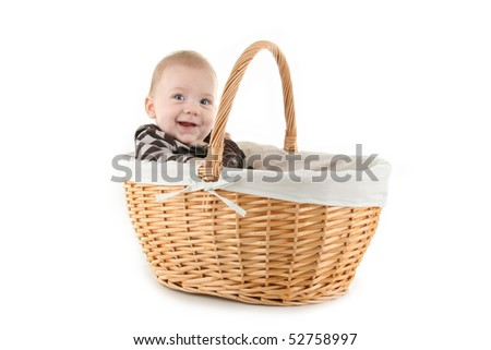 baby in basket on white background - stock photo