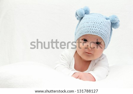 baby in blue knitted hat - stock photo