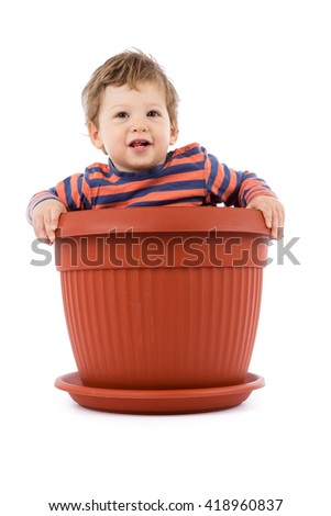 baby in flower pot - stock photo