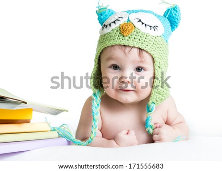 baby in funny owl knitted  hat owl with books  on white background - stock photo