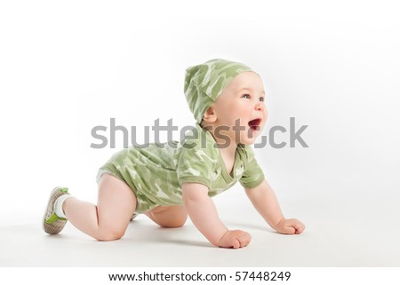 baby in khaki clothes - stock photo