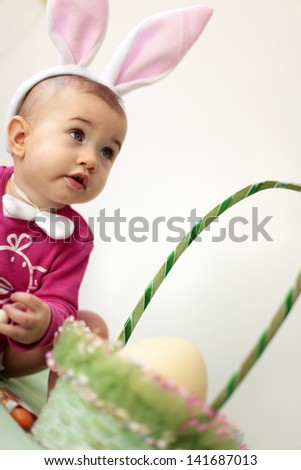 Baby in Rabbit ears for Easter - stock photo