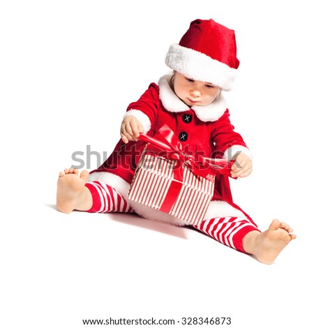 Baby in Santa Hat Open Christmas Gift Box on White Background - stock photo