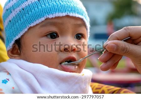 Baby in stroller - stock photo