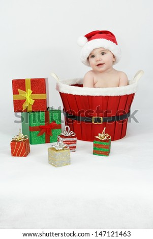 Baby in the basket with gifts - stock photo