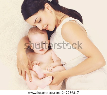 Baby in the mother's embrace - stock photo
