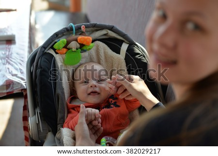 Baby in the trolley - stock photo
