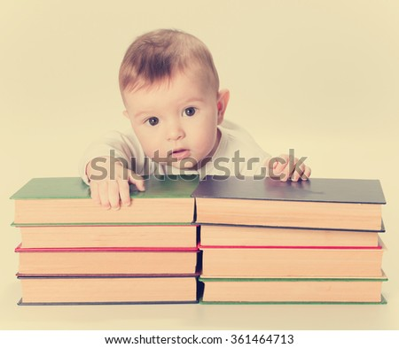 Baby, infant and Books, Kids Early Childhood Education Development, Smart Child Preschool Reading Concept, isolated on Background. - stock photo