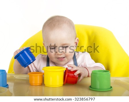 baby is playing with educational toys over white background - stock photo
