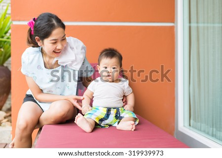 baby is trying to sit by himself. - stock photo