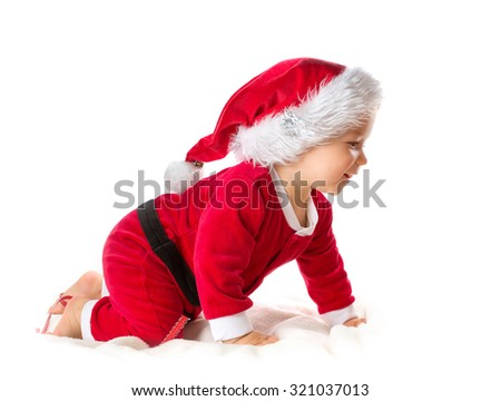 Baby isolated on white background crawling in santa costume - stock photo