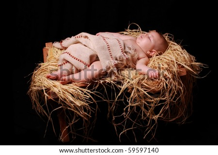 Baby Jesus asleep in the manger - stock photo