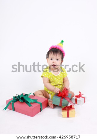 Baby laughing wearing party hat, little baby celebrate with heap of gift boxes, little baby on white background.  - stock photo