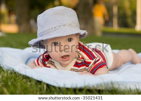 Baby lies on a stomach - stock photo