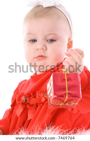 baby looking at present - stock photo