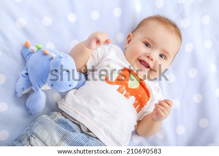 baby  lying on back - stock photo