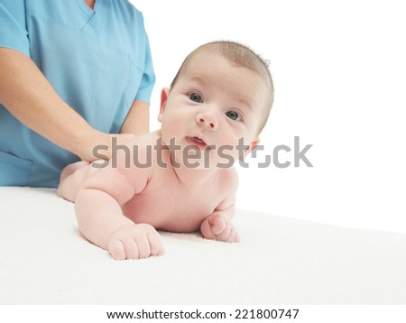 Baby massage doctor massage small caucasian baby boy isolated - stock photo
