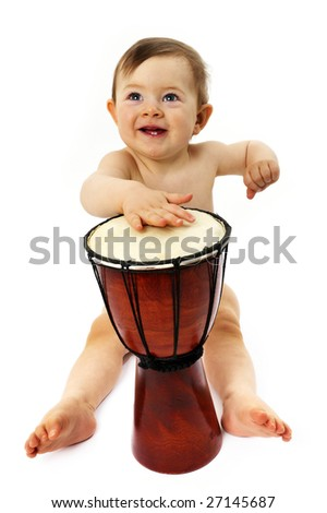 baby musicians play his instruments - stock photo