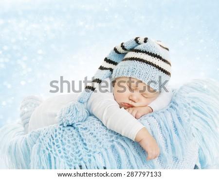 Baby New Born Hat Costume, Newborn Kid Sleeping on Blue blanket, Infant Six Months Dream - stock photo