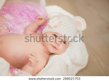 Baby newborn child sleep in basket cute little girl new born baby smiling, portrait of 1 month baby girl, adorable kid in cozy accessories at home, soft focus, mother care concept, series - stock photo