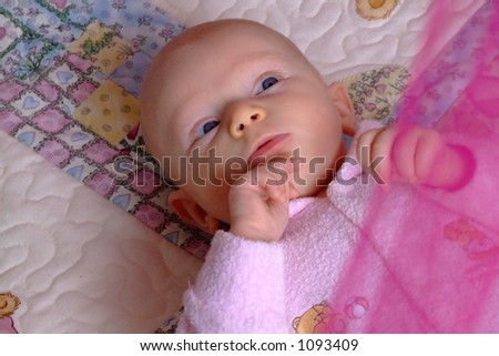 baby on back staring up - stock photo