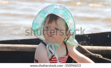 Baby on the boat - stock photo