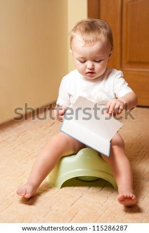 Baby on the pot, process of habituation - stock photo