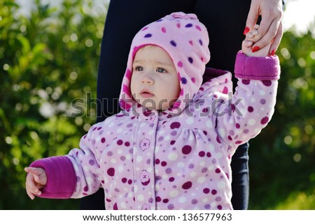 baby on the walk showing where to go - stock photo