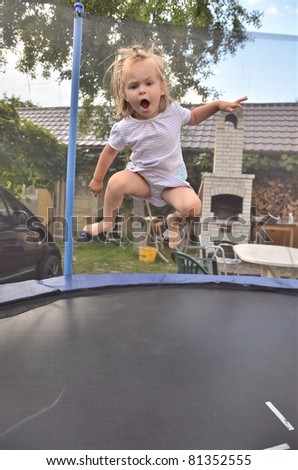 baby on trampoline - stock photo
