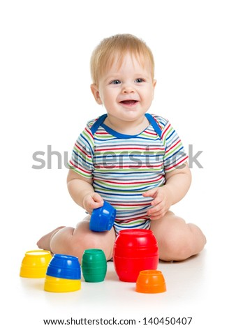 baby or kid playing with toys - stock photo