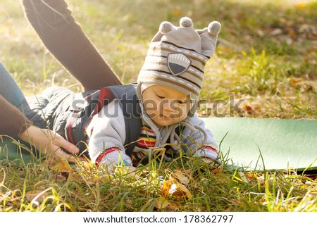 Baby outdoors close to nature and have fun - stock photo