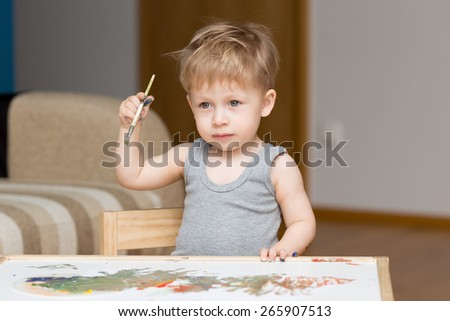 Baby painter. - stock photo