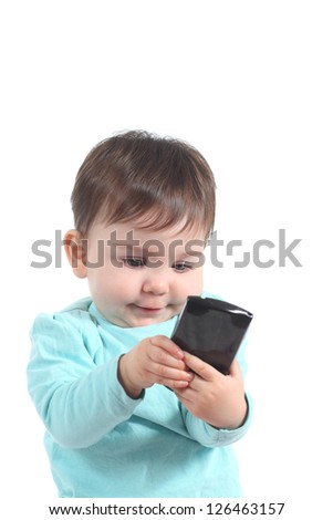 Baby playing with a mobile phone on a white isolated background - stock photo